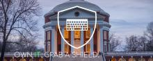 A picture of the UVA Rotunda, with a white shield and keyboard superimposed over the Rotunda with the words:  Own IT. Grab a Shield.
